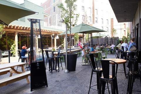 The patio space at Deuces & the Diamond Club in Wrigleyville features umbrellas, a fountain and heatlamps for chilly nights.