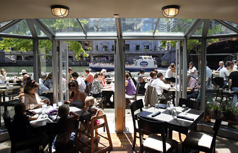 The patio at River North's Bridge House Tavern features riverside views.