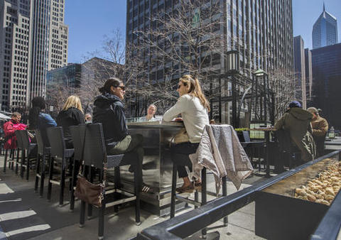 The sprawling patio at Howells & Hood features firepit tables and an outdoor bar in the shadow of the Tribune Tower.