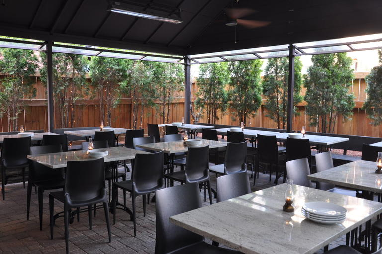Lincoln Square Restaurant Gather Features A Fully Covered Terrace.