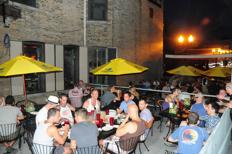 Boystown bar D.S. Tequila Co. features a sideyard deck with a retractable roof for rainy days.