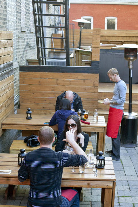 Bucktown bar and restaurant Red Door features a sideyard patio with communal seating.