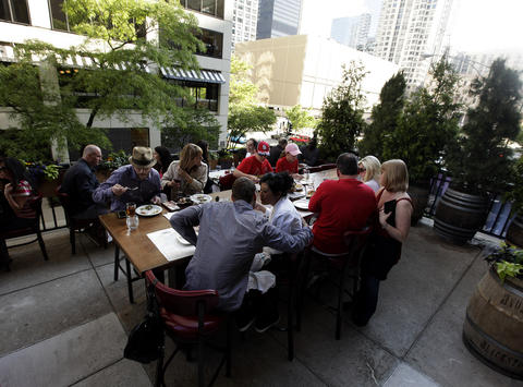 Wine and eat swing outside at Mag Mile restaurant The Purple Pig.
