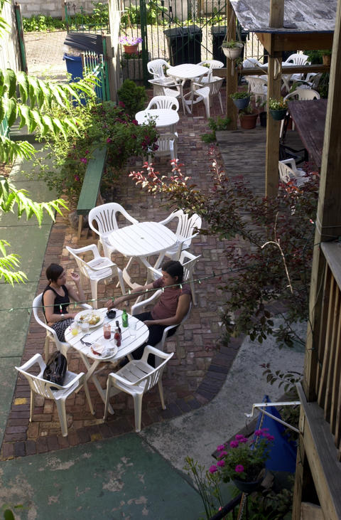 The backyard patio at veggie-centric hangout Handlebar is an escape from North Avenue traffic.