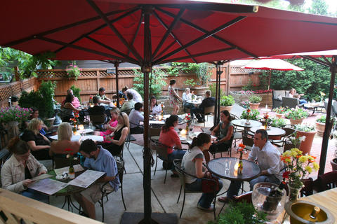 The picturesque backyard patio at Wicker Park's Enoteca Roma provides an escape from the hustle of Division Street.