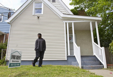 Tre'von takes a first look around a house his family is considering renting in a Southeast Newport News neighborhood.