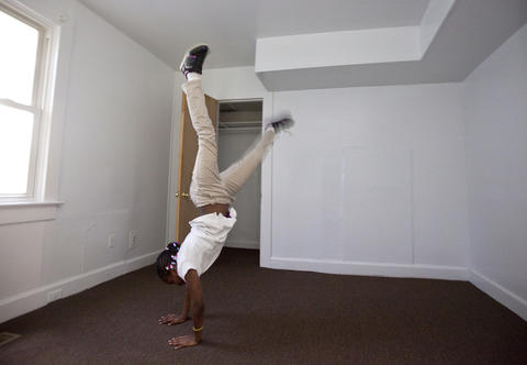Teá does a cartwheel as she explores the rooms of her family's new house for the first time on Friday, May 3.