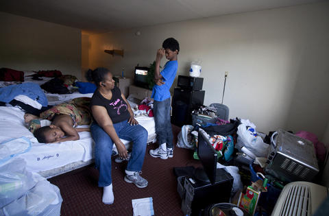 Tim sleeps as Eva and Terrell negotiate a plan for packing up the family's belongings from the Centerstone Inn on May 3. Terrell, who stayed home sick from school, reconsidered his decision after his mother enlisted his moving assistance.