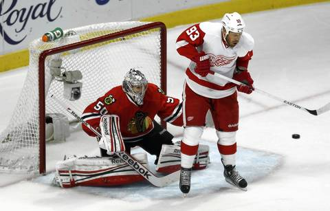 Corey Crawfors is screened by the Red Wings' Johan Franzen.