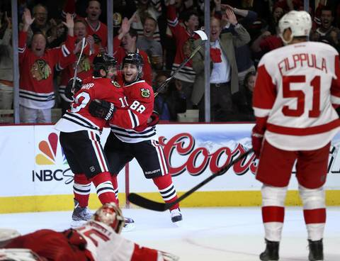 Patrick Kane (88) celebrates with teammate Patrick Sharp (10) after Kane's first-period goal.