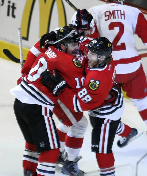 Patrick Kane and Patrick Sharp celebrate Kane's first-period goal.