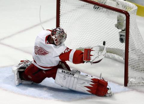 Patrick Kane's goal gets past Detroit Red Wings' Jimmy Howard in the first period.