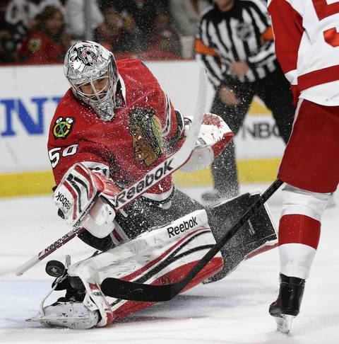 Corey Crawford (50) makes a save on a shot by Detroit Red Wings center Valtteri Filppula (51) in the second period.