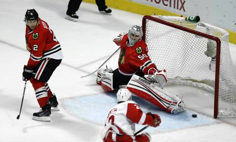 Corey Crawford can't stop Detroit Red Wings' Brendan Smith's goal.