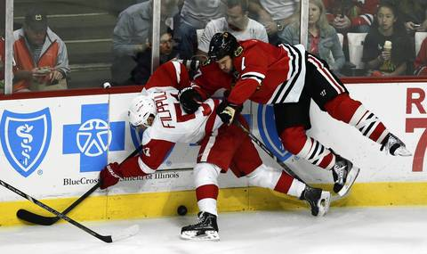 Chicago Blackhawks' Brent Seabrook checks Detroit Red Wings' Valtteri Filppula in 2nd period.