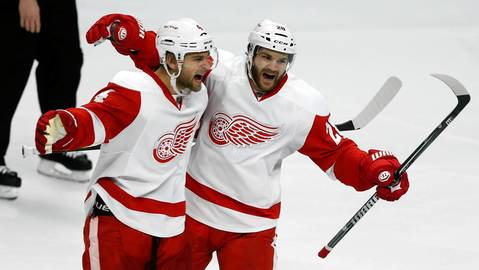 Jakub Kindl and Carlo Colaiacovo celebrate Damien Brunner's second-period goal.