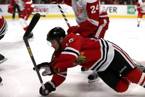 Chicago Blackhawks center Marcus Kruger (16) falls to the ice in the third period.