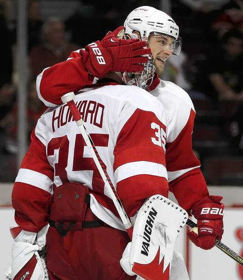 Detroit Red Wings defenseman Jakub Kindl (4) congratulates teammate Jimmy Howard (35) after defeating the Chicago Blackhawks.