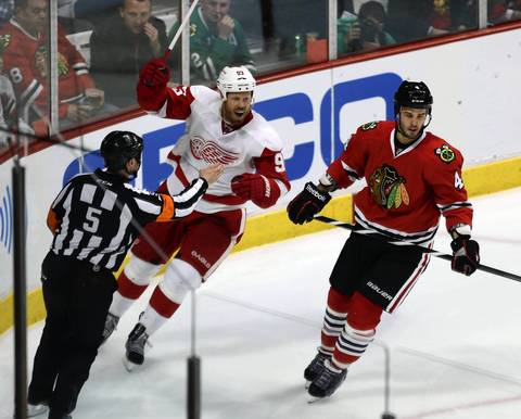 Detroit Red Wings' Johan Franzen celebrates his 3rd period goal as Chicago Blackhawks' Niklas Hjalmarsson skates away.
