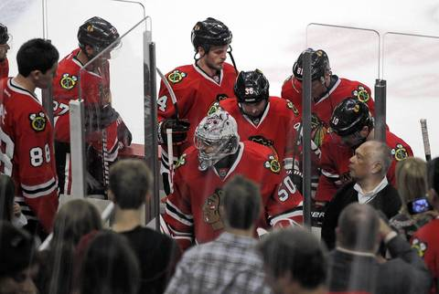 Goalie Corey Crawford and the Blackhawks head to the locker room after the 4-1 loss.