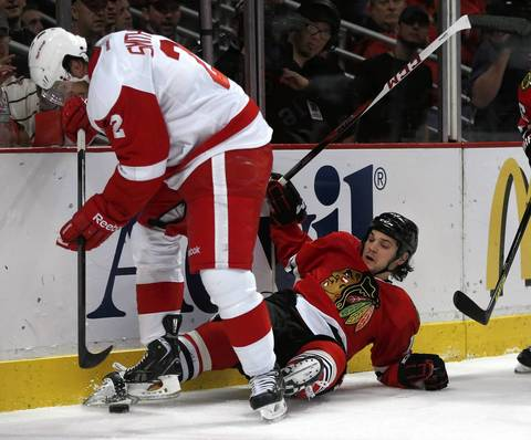 Daniel Carcillo gets tangled up with the Red Wings' Brendan Smith along the boards in the first period.