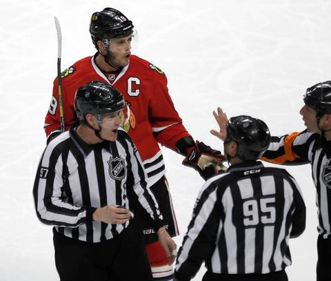 Jonathan Toews complains about a decision.