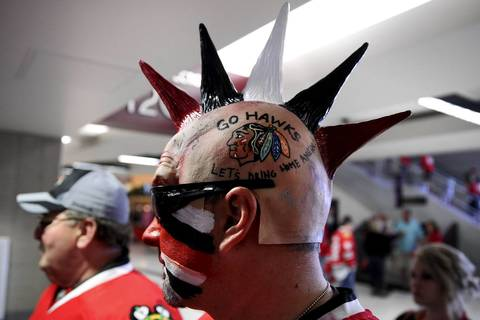 Jack Basich of Portage, Ind., shows his love for the Blackhawks as he waits in a concession line at the United Center.