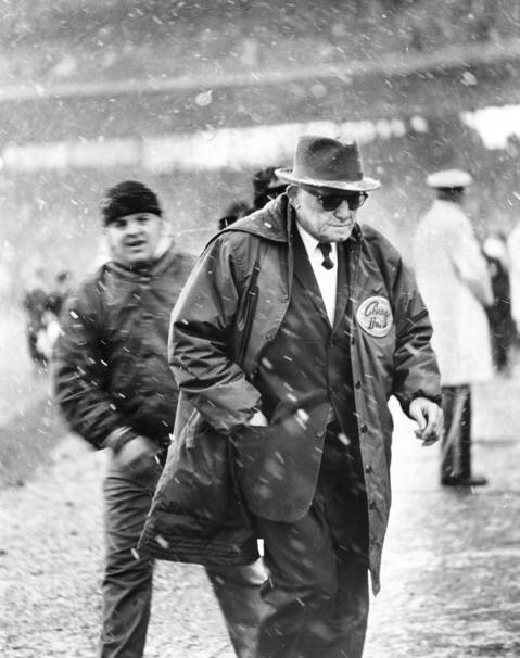 "George ""Papa Bear"" Halas meant everything to the sport he devoted his life to as a player, founder, owner and coach. Founded the Decatur Staleys in 1920, moved the team to Chicago in 1921 and then, as player-owner-coach, changed the name to the Bears, where he was coach until 1983, collecting 324 wins and six NFL titles. Halas was also instrumental in the formation of the National Football League, representing the Staleys at the first organizational meeting in Canton, Ohio. He was elected to the Hall of Fame in 1963."