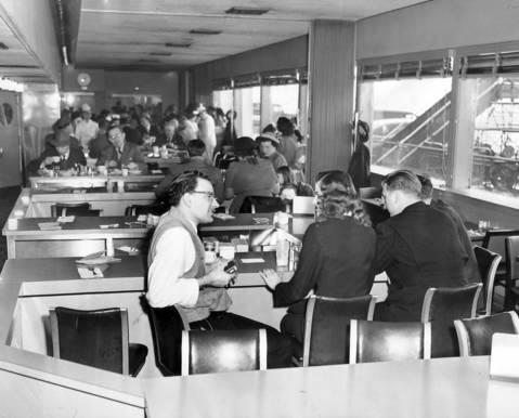 The coffee shop at Chicago Midway Airport, run by Marshall Fields & Co., was decorated with a modern color scheme of aqua blue and yellow on Feb. 19, 1949. The airport is said to have had the finest eating facilities of any airport in the country.