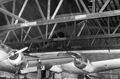 Fred Frabin, Monarch Airlines supervisor, looks at tornado damage to the airlines hanger at Midway Airport on May 9, 1964. Part of the roof of the hanger was blown against a truck, knocking it over.