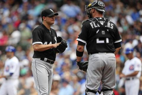 Sox starting pitcher Jake Peavy talks to catcher Tyler Flowers as he gives up two runs in the second inning.