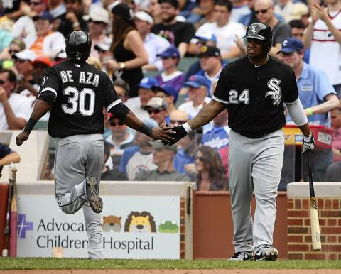Dayan Viciedo greets Alejandro De Aza as he scores against the Cubs in the third inning.