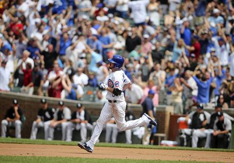Travis Wood hits a grand slam off Sox starting pitcher Jake Peavy in the fourth inning.