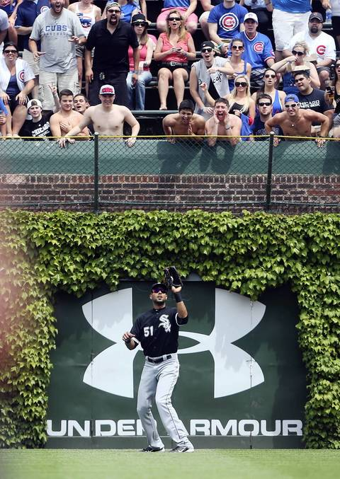 Bleacher fans yell at Sox right fielder Alex Rios as he catches a fly ball to end the second inning.