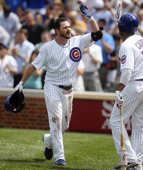 Travis Wood celebrates his grand slam off in the fourth inning.