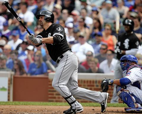 Paul Konerko hits an RBI single in the third inning.
