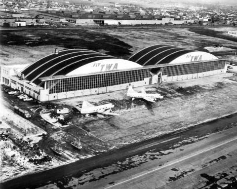 A bird's-eye view of Trans World Airlines' new $2.5 million dollar hanger, recently completed at Chicago's Midway Airport. The hanger was officially dedicated on Friday, January 23, 1953. The double-span structure, which took nearly a year to build, can house four 4-engine Lockheed Constellations or six twin-engine Martin planes.