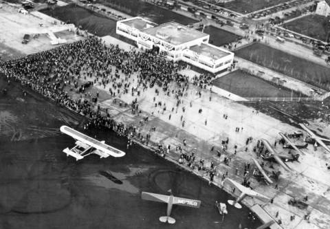 Chicago's Municipal Airport is dedicated and given the first Illinois airport license issued. An air view of the grounds at 63rd Street and Cicero Avenue show the new $100,000 union terminal building and other improvements in which $774,000 had been invested. Chicgao Mayor Anton Cermak spoke and was presented with the state license by Maj. Reed G. Landis, chairman of the state aeronautics commission on Nov. 15, 1931.