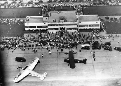 Crowds gathered at Chicago Municipal Airport in July 1932 for Governor Franklin D. Roosevelt who flew to Chicago to personally accept the Democratic nomination for president. At left is the plane in which the Democratic nominee made the trip from Albany, New York.