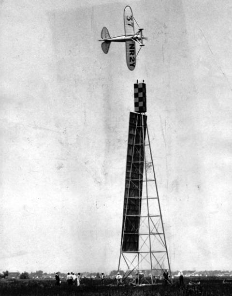A plane piloted by Joe Jacobson rounded a pylon during the American Air Races held at Chicago Municipal Airport in July 1933. Jacobson won a trophy.