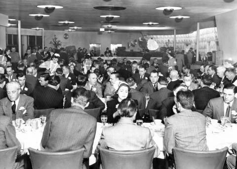 The preview evening opening of The Cloud Room on March 18, 1948, a new restaurant operated by Marshall Fields & Co. at Chicago Municipal Airport.