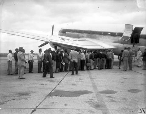 Fifty Mexican people board a U.S. Border Patrol plane on Sept. 21, 1954, as they are deported from Midway Airport. The group was flown to Brownsville, TX. where they were put on a boat for Veracruz, Mexico.