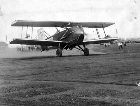 The National Air Transport (later United Air Lines) Curtiss Carrier Pigeon corporation plane, christened Miss Chicago, is shown taking off with a load of mail that would eventually get to Dallas, Texas during the opening ceremonies of the city's new air field, Chicago Municipal Airport, at 63rd Street and Cicero Avenue in Chicago on May 8, 1926. City leaders hailed the event as opening a new chapter in Chicago's development.
