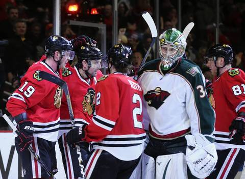 Patrick Sharp celebrates his goal while Wild goalie Darcy Kuemper skates off in the third period of Game 5.