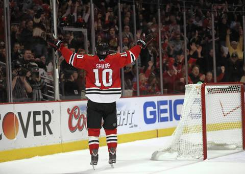 Patrick Sharp celebrates after his second goal of the third period against the Wild in Game 2.