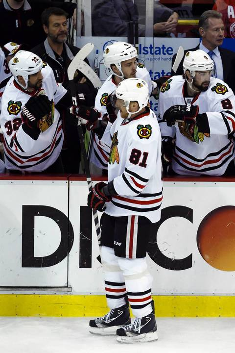 Marian Hossa is congratulated after he scored a goal in the first period against the Red Wings in Game 6.