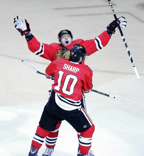 Marian Hossa and Patrick Sharp celebrate Hossa's 1st period goal against the Red Wings during Game 1.