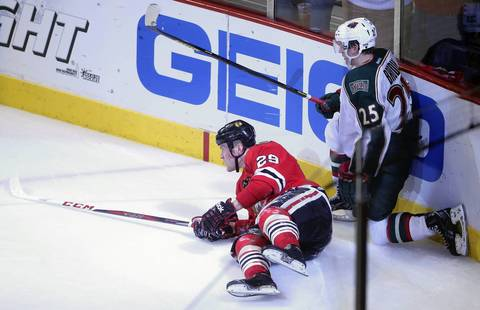 Bryan Bickell watches his empty net goal slide in against the Wild in the third period of Game 2.