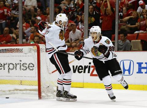 Patrick Kane celebrates his third period goal with Brandon Saad during Game 3 against the Red Wings.