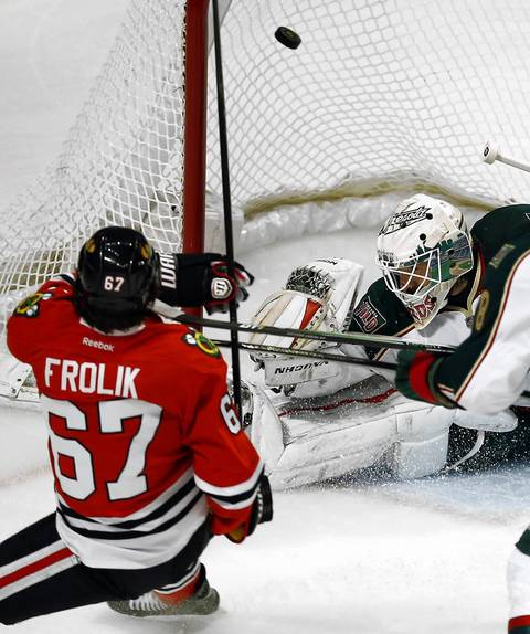 Michael Frolik scores on Wild goalie Josh Harding during the first period of Game 2.